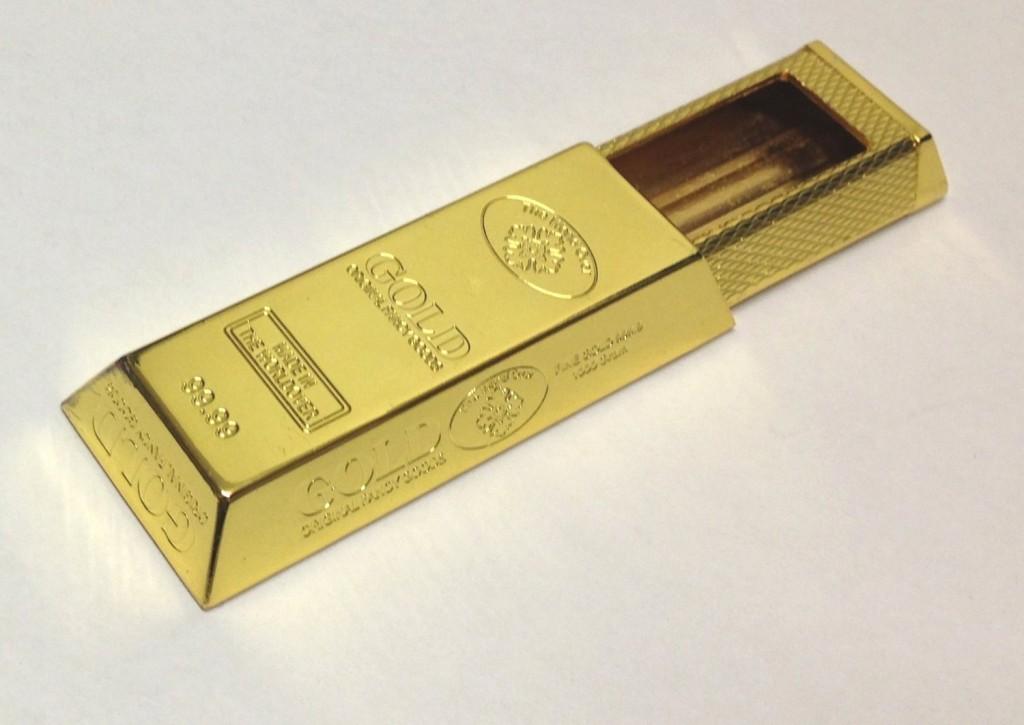 Taschenaschenbecher in Form eines Goldbarren